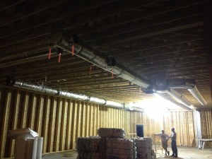 Installation of duct work in the dining area.