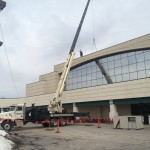 Commercial equipment being lifted to the roof.